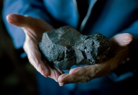 """Former miner Orval """"Hoppy"""" Ray holds a chunk of lead removed from a mine in Picher. The piece ways approximately 15 pounds. Hoppy ran the Pastime pool hall that doubled as a historic museum up until his death in September of 2010."""
