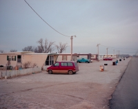 Mobile homes line a street in Picher, Oklahoma beside a large former lead mine.  These homes have since been bought and removed.